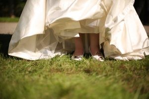 Bride's shoes at an outdoor Wisconsin wedding ceremony in River Falls WI.