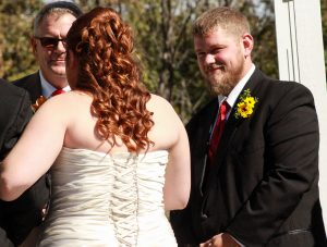 The grrom gives the bride a look of love An outdoor Wisconsin wedding ceremony in River Falls WI.