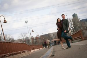 middle of the Stone Arch bridge pose. Engagement photos Minneapolis MN