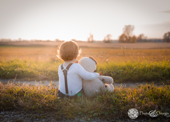 Little boy with bear, looking into sunset, toddler photos